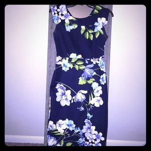 Long fitted blue and flowered dress.